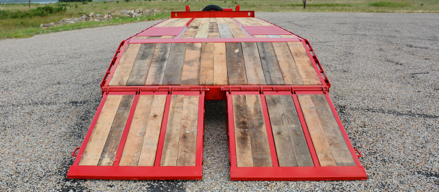 Model PX Pintle Hitch trailer with oak floor and wood filled dove and ramps