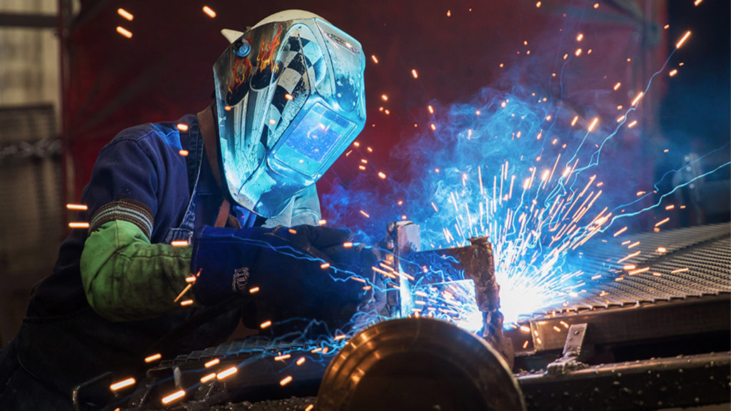 Welder working on a trailer