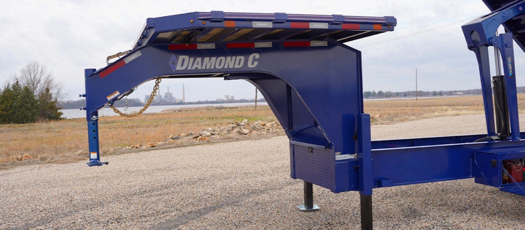 Model WDT dump trailer with gooseneck package and deck on the neck
